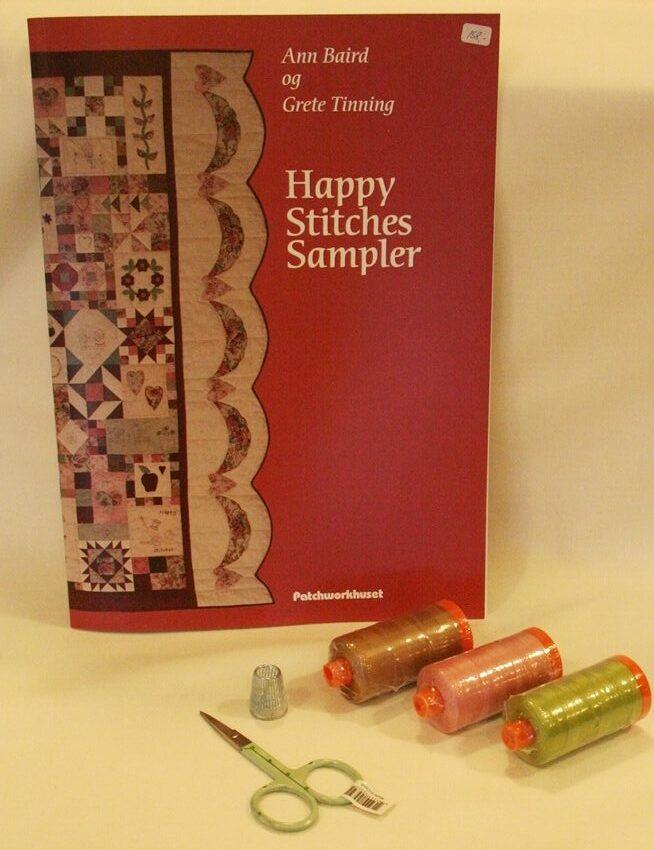 Happy Stitches Sampler - en quilt med mange forskellige mønstre.